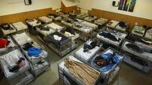 Homeless people sleep in double-bunk beds in the former chapel of the First United Church on the Downtown eastside of Vancouver April 27, 2010. (Jeff Vinnick For The Globe and Mail/Jeff Vinnick For The Globe and Mail)