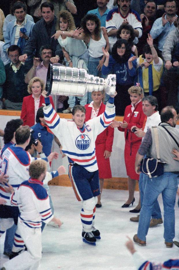 Canadian hockey player Wayne Gretzky #99 of the Edmonton Oilers raises the Stanley Cup over his head in victory after the Oilers defeated the Philadelphia Flyers, Edmonton, Alberta, Canada, May 31, 1987.