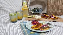 South American arepas with barbacoa-type filling of shredded beef, with vinegary coleslaw and white wine sangria. (Deborah Baic/The Globe and Mail)