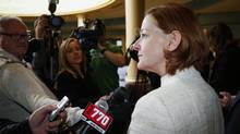 Alberta Premier Alison Redford scrums with the media following a meeting of the provincial PC Party executive in Calgary, Alta., Saturday, March 15, 2014. (Jeff McIntosh/THE CANADIAN PRESS)