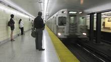 Riders wait for an approaching TTC subway at the the Main Street Station on Thursday, May 21, 2009. (Randall Moore/The Globe and Mail)
