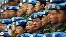 Chinese peacekeepers prepare to depart for their United Nations mission to Sudan from an airport in Zhengzhou, central Chinas Henan province, in this Tuesday, Jan. 16, 2007 file photo. (The Associated Press)