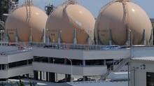 Liquefied petroleum gas storage tanks are seen at an industrial area in Yokohama in Kanagawa prefecture, south of Tokyo, Wednesday, Aug. 22, 2012. Japan slipped back into a trade deficit in July, as exports languished and imports of gas and generating equipment surged. (Itsuo Inouye/AP)