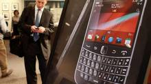 Analysts are prepared for more bad news when the BlackBerry maker reports its second-quarter results this week. (DAVE CHIDLEY/THE CANADIAN PRESS)