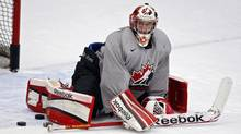 Goalie Jordan Binnington, from Richmond Hill, Ont., stretches during the National Junior hockey team selection camp in Calgary, Alta., Tuesday, Dec. 11, 2012. (Jeff McIntosh/THE CANADIAN PRESS)
