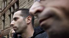 Alessandro (Sandro) Lisi, with his lawyer, Seth Weinstein, is escorted out of Old City Hall Court in Toronto on Nov. 1, 2013. (PETER POWER/THE GLOBE AND MAIL)