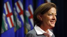 Alberta Premier Alison Redford on Tuesday suggested increasing the demand for natural gas by having more vehicles use it as fuel. (Jeff McIntosh/THE CANADIAN PRESS)