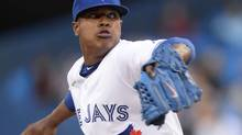 Toronto Blue Jays starting pitcher Marcus Stroman throws against the St. Louis Cardinals during first inning American League baseball action in Toronto on Friday, June 6, 2014. (Frank Gunn/THE CANADIAN PRESS)