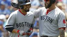 Shane Victorino, left, and Mike Napoli are just two of the Red Sox who have eschewed shaving this season. (Colin E. Braley/AP)