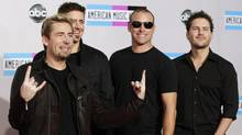 Rock band Nickelback poses on arrival at the 2011 American Music Awards in Los Angeles November 20, 2011. (Danny Moloshok / REUTERS/Danny Moloshok / REUTERS)