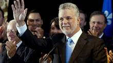 Philippe Couillard waves to supporters as he announces his candidacy for the leadership of the Quebec LiberalsWednesday, October 3, 2012 in Montreal. (Paul Chiasson/THE CANADIAN PRESS)