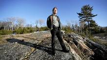 Ken Noble, a member of the Henvey Inlet First Nation is photographed standing on a rock outcrop overlooking Key Inlet. The band is in plans to develop a 300 megawatt wind power project on the 10 000 acres they own. The project will take advantage of the steady winds coming off nearby Georgian Bay and funds generated will allow them to develop needed social services for band members. (Fred Lum/The Globe and Mail/Fred Lum/The Globe and Mail)