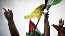 Palestinians from the Gaza Strip celebrate the political unity deal in a demonstration at the Unknown Soldier square in Gaza City where for the first time since 2007 the yellow Fatah flag is allowed to be displayed on May 4, 2011. (MARCO LONGARI/MARCO LONGARI/AFP/Getty Images)