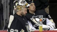 Pittsburgh Penguins goalie Tomas Vokoun (92) stands next to fellow goalie Marc-Andre Fleury (29) during a third period time out in Game 1 of the NHL hockey Stanley Cup Eastern Conference finals against the Boston Bruins in Pittsburgh, Saturday, June 1, 2013. (Gene J. Puskar/AP)