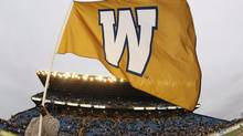 A flag waves at Canad Inns Stadium in Winnipeg (John Woods/The Canadian Press)