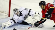 Los Angeles Kings goalie Jonathan Bernier, left, stops a shot by Calgary Flames' Jarome Iginla during first period NHL action in Calgary, Alta., Wednesday, Feb. 20, 2013. (Jeff McIntosh/THE CANADIAN PRESS)