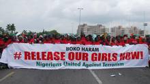 The Nigerians United Against Terrorism group attend a demonstration calling on the government to rescue the kidnapped girls of the government secondary school in Chibok, in Abuja, Nigeria, May 26, 2014. (Gbenga Olamikan/Associated Press)