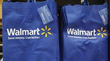Re-useable Wal Mart bags are seen in a newly opened Wal-Mart neighborhood market in Chicago 2011. The chain is now considering new distribution techniques to compete with online retailers. (JIM YOUNG/REUTERS)
