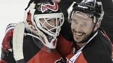 New Jersey Devils goalie Martin Brodeur (L) is congratulated by teammate Ilya Kovalchuk after the Devils defeated the Philadelphia Flyers on Brodeur's 40th birthday in Game 4 of their NHL Eastern Conference semi-final playoff hockey game in Newark, New Jersey, May 6, 2012. REUTERS/Ray Stubblebine (RAY STUBBLEBINE)
