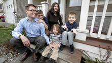 Steve and Tanya Wellburn and their children Fiona, 2, Gregory, 6, and Crispin,11, pose for a photo on the front deck of their home where Stephen Harper made an announcement during his election campaign tour in Saanich, where conservative candidate Troy DeSouza is running in the Esquimalt-Juan de Fuca riding, near Victoria, BC, Monday morning. (Deddeda Stemler for The Globe and Mail/Deddeda Stemler for The Globe and Mail)