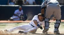 Toronto Blue Jays Omar Vizquel gets tagged out by Tampa Bay Rays catcher Jose Molina (R) to end the game during the ninth inning of their American League baseball game in Toronto, September 1, 2012. (MARK BLINCH/REUTERS)