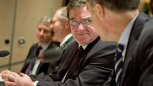 Finance Minister Jim Flaherty speaks to Bank of Canada Governor Mark Carney before meeting with his provincial and territorial and counterparts in Victoria on Dec. 19, 2011. (GEOFF HOWE/Geoff Howe/The Canadian Press)