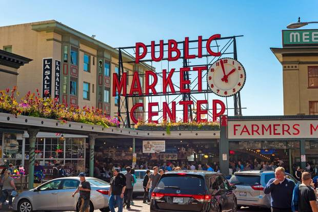 SEATTLE, WA - SEPTEMBER 11, 2016: The Pike Place Market, with its famous sign and clock, attracts large crowds of visitors every day. Credit: iStock Editorial / Getty.