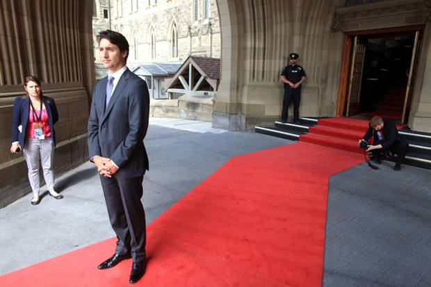 As the Prime Minister awaits the arrival of Mexico's visiting President on Parliament Hill, his ever-present official photographer, Adam Scotti, prepares to capture the moment.