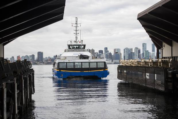 A TransLink SeaBus arrives at the Lonsdale Quay SeaBus station in North Vancouver, B.C., on August 20, 2015.