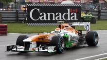 Force India driver Paul di Resta enters the pits during the morning practice session at the Canadian Grand Prix, Friday, June 7, 2013 in Montreal. THE CANADIAN PRESS/Ryan Remiorz (Ryan Remiorz/THE CANADIAN PRESS)