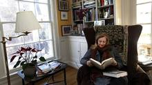 Anna Porter in her favourite reading spot in her home in Toronto this week. (Deborah Baic/The Globe and Mail)
