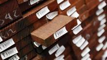 Labelled DNA timber are seen on display at Masters warehouse in west Sydney. Stores are increasingly worried about being duped by a global trade in illegal timber worth billions. (DANIEL MUNOZ/Reuters)