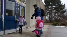 Hilton Barbour takes his daughters, four year old Savanna and Seven year old Monet to school in Toronto on Jan/ 11, 2013. (Chris Young For The Globe and Mail)
