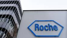 File photo of the logo of Swiss pharmaceutical company Roche outside their headquarters in Basel January 30, 2014. Roche Holding AG has agreed to buy U.S. biotech company InterMune Inc for $8.3-billion in cash, marking the latest multibillion-dollar deal in a consolidating pharmaceutical sector. (RUBEN SPRICH/REUTERS)