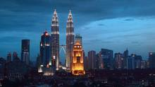 The Petronas Twin Towers in Kuala Lumpur, Malaysia. (Goh Seng Chong/Bloomberg News)