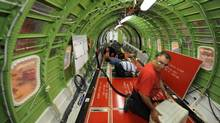 Workers lay cables and wiring in a Global Express jet being manufactured at Bombardier Inc.'s Downsview assembly plant in this file photo. (Fred Lum/Fred Lum/The Globe and Mail)
