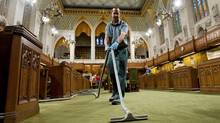 A janitor vacuums the House of Commons on Nov. 17, 2008 in preparation for the start of Parliament. (Sean Kilpatrick/The Canadian Press)