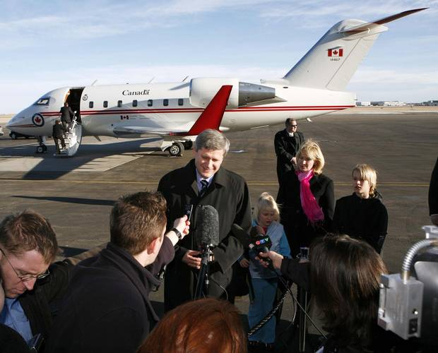 Prime Minister Stephen Harper talks to the media at the Calgary International Airport on Dec. 21, 2006.