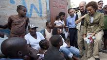 Then-governor-general Michaëlle Jean and her husband Jean-Daniel Lafond chat with a displaced family in Haiti last March. (Paul Chiasson/Paul Chiasson/The Canadian Press)
