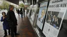 People view various newspaper front pages showing President Barack Obama's victory over Republican presidential candidate Mitt Romney. (GARY CAMERON/REUTERS)