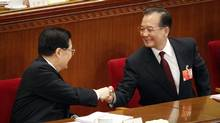Chinese Premier Wen Jiabao, right, is greeted by Chinese President Hu Jintao after his speech during the opening session of the National People's Congress in Beijing's Great Hall of the People, China, Monday, March 5, 2012. (Vincent Thian/Vincent Thian/AP)