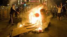 Protesters start a fire during a demonstration in Montreal, Saturday, May 19, 2012. (Graham Hughes/Graham Hughes/THE CANADIAN PRESS)