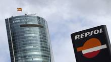 A Repsol logo is seen in front of Torre Espacio building in Madrid April 13, 2012. (SUSANA VERA/REUTERS)