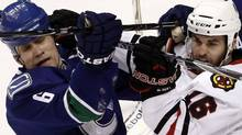 Chicago Blackhawks left wing Andrew Ladd (R) gets his stick up into the face of Vancouver Canucks defenseman Sami Salo in the first period during Game 4 of their NHL Western Conference semi-final hockey game in Vancouver, British Columbia May 7, 2010. REUTERS/Andy Clark (ANDY CLARK)
