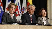 Ontario Premier Kathleen Wynne, left, speaks as Manitoba Premier Greg Selinger, centre, and Alberta Premier Alison Redford, right, look on at a press conference following the 2013 Council of the Federation fall meeting in Toronto on Nov. 15, 2013. (Mark Blinch/The Canadian Press)