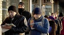 Jobless people queue outside an unemployment office in Madrid. Spain's unemployment rate is expected to rise to 26.6 per cent next year, from 25 per cent in 2012. (Arturo Rodriguez/AP)