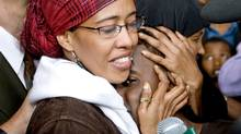 Suaad Hagi Mohamud embraces her 12-year-old son upon arriving at Pearson airport in Toronto on Aug. 15, 2009, after a three-month ordeal in Kenya. (Darren Calabrese/The Canadian Press)
