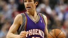 Steve Nash #13 of the Phoenix Suns dribbles the ball against the Portland Trail Blazers at the Rose Garden on March 18, 2008 in Portland, Oregon. NOTE TO USER: User expressly acknowledges and agrees that, by downloading and or using this Photograph, user is consenting to the terms and conditions of the Getty Images License Agreement. (Photo by Jonathan Ferrey/Getty Images)