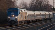 An Amtrak/VIA train from New York to Toronto passes through Oakville April 22, 2013. (For the Globe and Mail/Philip Cheung)
