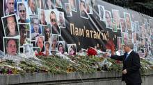 Prime Minister Stephen Harper lays a bouquet of flowers at a makeshift memorial on Hrushevsky Street in Kiev on March 22, 2014. (SEAN KILPATRICK/THE CANADIAN PRESS)